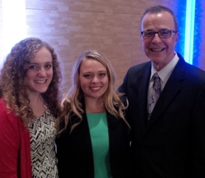 Melaina Lewis (center) with her mentee, Jess Carnprobst after accepting the Ron Culp Scholarship for Mentorship
